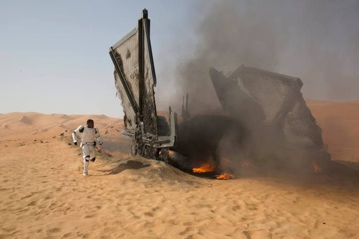 Finn leaves the wreckage of a crashed TIE Fighter